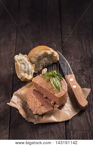 Duck liver pate with bread and basil rustic style still-life