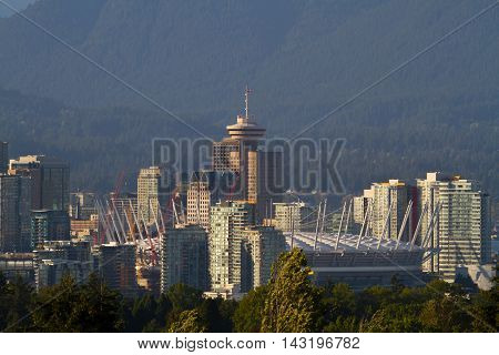 This is a photo of downtown Vancouver B.C.  The mountains in the background are in North Vancouver.
