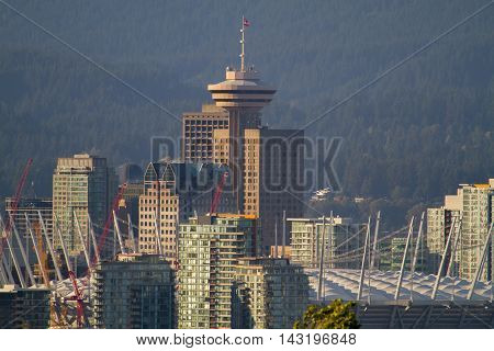 This is downtown Vancouver, B.C.  The tower is called The Harbour Center.  The stadium with the large white roof is B.C. Place Stadium.