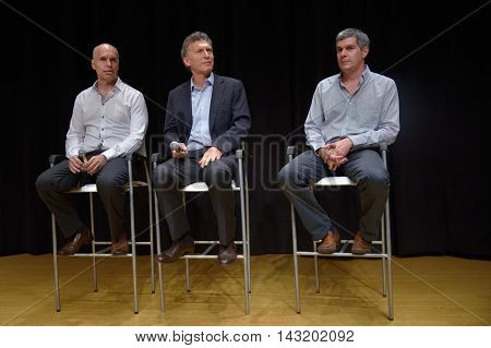 BUENOS AIRES ARGENTINA - NOV 10 2015: Mauricio Macri (C) presidential candidate for Cambiemos and the Chief of Government of the Autonomous City of Buenos Aires flanked by Buenos Aires' City elected Mayor Horacio Rodriguez Larreta and his advisor Marcos P