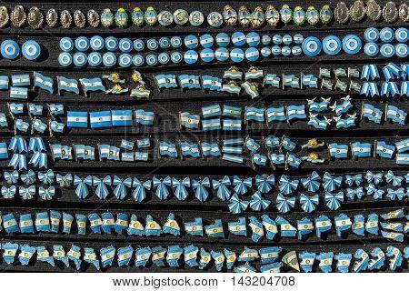 Buenos Aires Argentina - June 12 2016: A lot of Argentine pins on black board at the Feria de Mataderos Fair sunday fair in Buenos Aires Argentina.