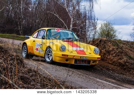 Moscow Russia - Apr 18 2015: Porsche 911 RSR finnish driver Ville Silvasti and his codriver Jonne Halttunen during the Rally Masters Show 2015 at the Krylatskoye District.