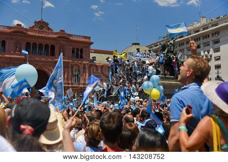 Buenos Aires Argentina - Dec 10 2015: Supporters of the newly elected Argentinean president wave flags on inauguration day at the Plaza de Mayo.