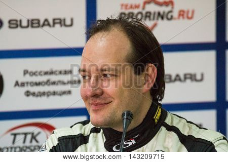 Moscow Russia - Apr 18 2015: Co-driver Arnautov Alexey during a press conference after the Rally Masters Show 2015.