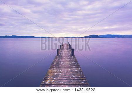 Romantic Scene At A Pier Looking Out Upon Lake Rotorua At Sunrise