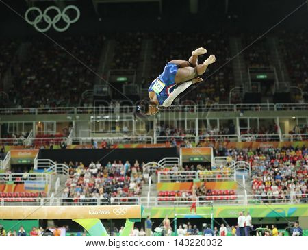 RIO DE JANEIRO, BRAZIL - AUGUST 11, 2016: Olympic champion Simone Biles of United States competing on the balance beam at women's all-around gymnastics at Rio 2016 Olympic Games
