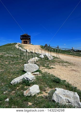 Cement Ridge Fire Lookout Tower with country road lined by limestone boulders in the Black Hills of South Dakota USA