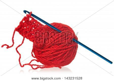 Model of knitting on spokes over white background close-up