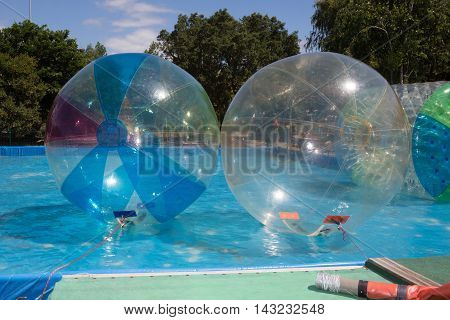 Inflatable Balloon On Water. The Ball In Water - Water Zorbing.