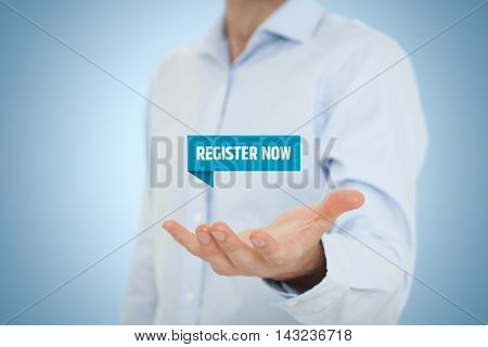Register now concept. Businessman hold virtual label with text register now.