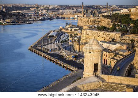 Malta - Watch tower of Valletta with seafront, Floriana and Grand Harbour at background