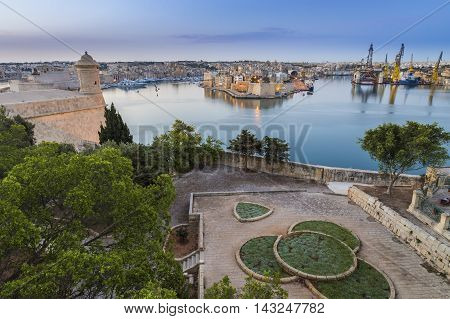 Valletta, Malta - Early morning skyline view of the Grand Harbour of Malta with watch tower and Senglea at the background