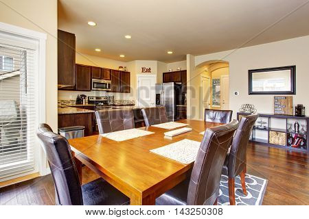 Open Floor Plan Dining Area Connected To Modern Kitchen