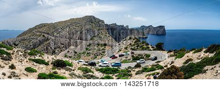 Panorama of a hairpin turn and the winding road with parked cars on the Cap de Formentor in Mallorca, Spain