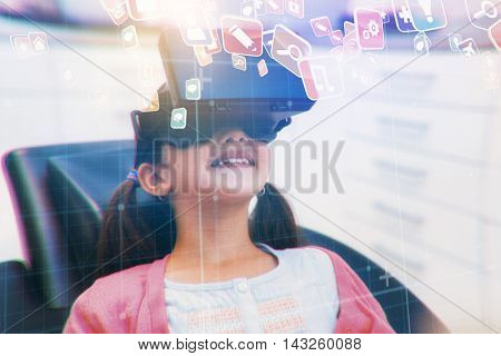 Colourful computer applications against girl using virtual reality headset during a dental visit