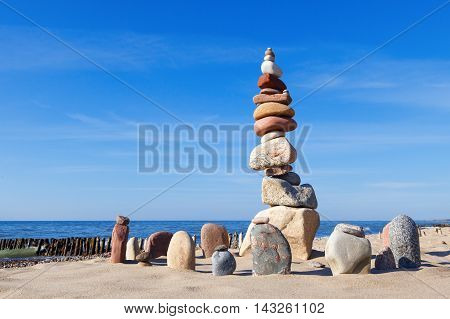 Concept of harmony and balance. Balance and poise stones against the sea. Rock zen against the sea