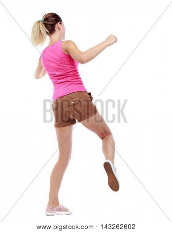 back view of woman funny fights waving his arms and legs. Rear view people collection. backside view of person.  Isolated over white background. Sport blond in brown shorts hit someone