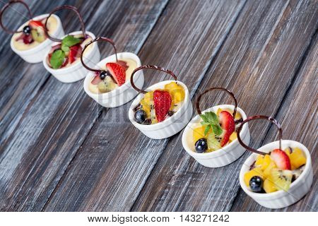 beautiful dessert with fruits and berry on wood background