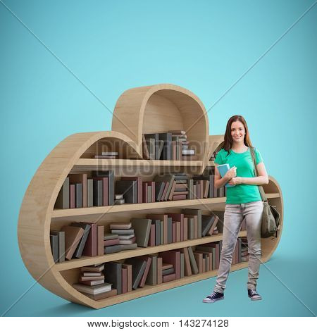 Student smiling at camera in library against blue vignette background