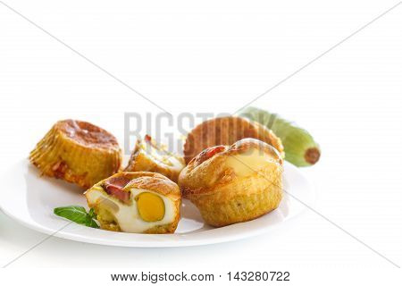 zucchini muffins baked with egg inside on a white background