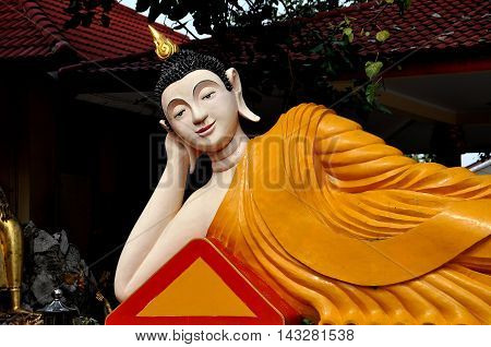 Bang Saen Thailand - January 7 2010: Reclining Buddha figure reaching Nirvana at a Kuan-Yin Chinese temple on Sam Muk Hill