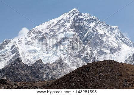Summit of mt. Nuptse from route to mt. Everest Base Camp near Gorak Shep Sagarmatha National Park Solu Khumbu Nepal.