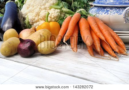 fresh vegetables for potage on a white table