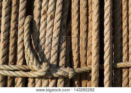 Natural rope made of fibre as background with spliced eyes attached to each other. poster