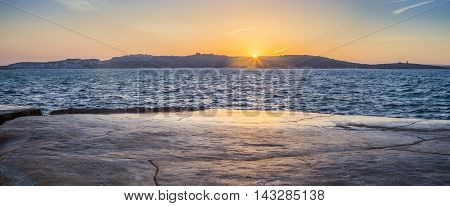Malta - Panoramic view of sunset at Bugibba with St.Paul's island at background