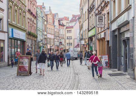 JELENIA GORA POLAND - AUGUST 17 2016: Tourists Walking Through Historic Downtown in Jelenia Gora Poland