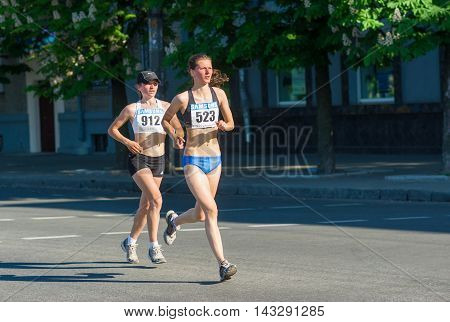 DNEPROPETROVSK, UKRAINE - MAY 09, 2013: Anastasiya Pisika (523) - the second place of the half marathon under-21 race at the city streets during Ukrainian opened athletics championship  Dnepropetrovsk, Ukraine at May 09, 2013