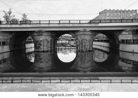 Bridge With Reflection In Water Black And White