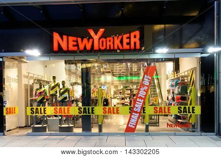 FRANKFURT AM MAIN GERMANY - AUGUST 7 2015: New Yorker store on Zeil at night a German clothing retailer headquartered in Braunschweig. By 2011 the company owned 857 branches in 36 countries.