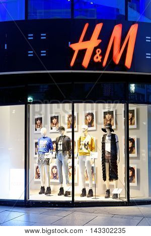 FRANKFURT AM MAIN GERMANY - AUGUST 7 2015: HM store on the famoust Zeil shopping street at sun set. H&M is a Swedish multinational retail-clothing company.