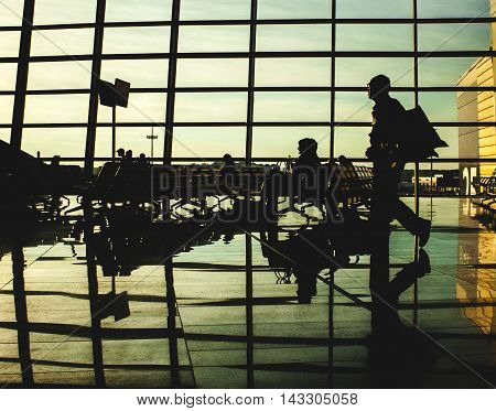 photo of people silhouettes in airport lounge
