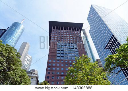 FRANKFURT AM MAIN GERMANY - AUGUST 6 2015: Highrise buidlings left to right - Main Tower Garden Tower Japan Center Commerzbank Tower Taunus Tower.