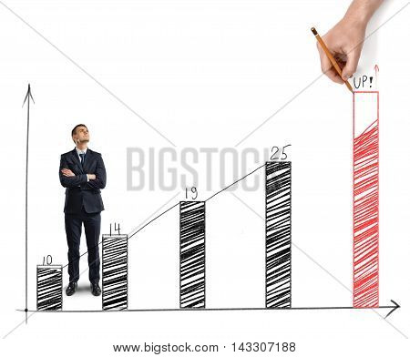 Businessman standing alongside a sketched increasing bar graph with a hand drawing the final bar in red showing the target and the necessary improvement required to meet the goal