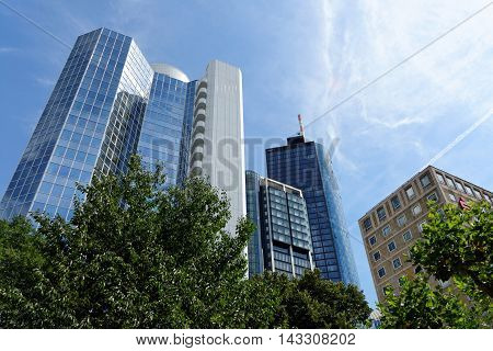 FRANKFURT AM MAIN GERMANY - AUGUST 6 2015: Highrise buidlings left to right - Bank of Communications Eurotheum Main Tower. Frankfurt is the largest financial center in continental Europe.