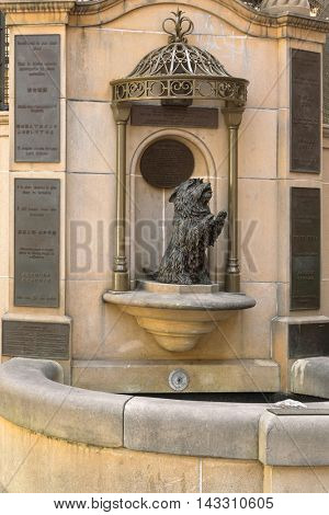 SYDNEY, AUSTRALIA - APRIL, 2016: Statue of Queen Victoria's favorite dog pet named Islay in Sydney, Australia on April 21, 2016. Dog above wishing well for Royal Institute for Deaf and Blind Children