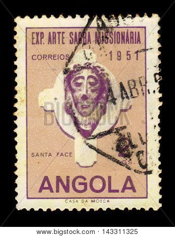 ANGOLA - CIRCA 1952: A stamp printed in Angola shows a head of Christ, exhibition of sacred missionary art issue, lilac, ochre, circa 1952