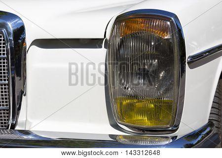 Detail of an attique car at a retro car parade. Headlights. Headlamp.