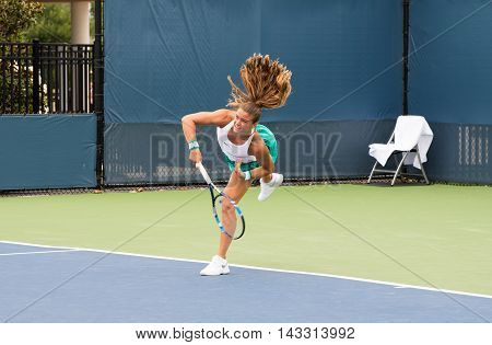 Mason Ohio - August 13 2016: Maria Sakkari in a qualifying match at the Western and Southern Open in Mason Ohio on August 13 2016.