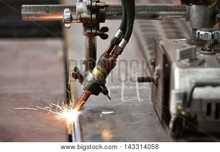 LPG cutting with sparks close up in factory