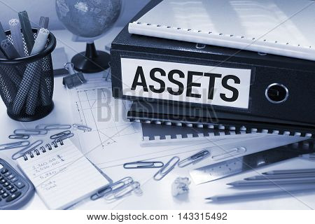 Assets concept with file on office desk