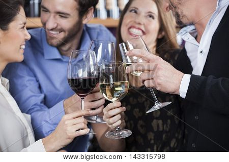 Friends Toasting Wine Glasses At Shop