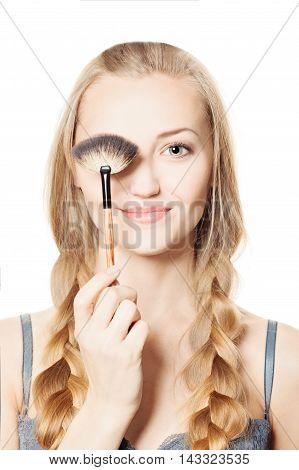 Makeup. Cute Smiling Girl holding Makeup Brush
