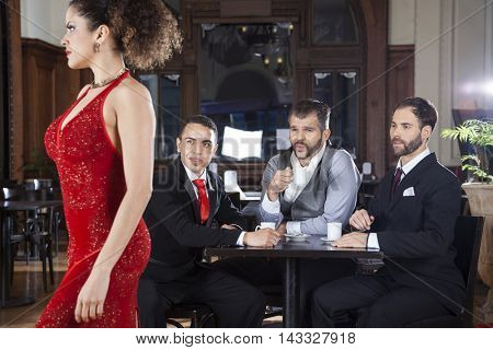 Pervert Customers Looking At Tango Dancer In Restaurant