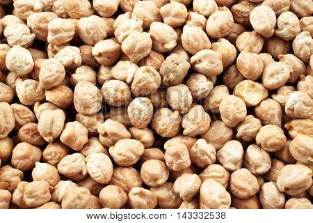 A close up image of dried chick peas