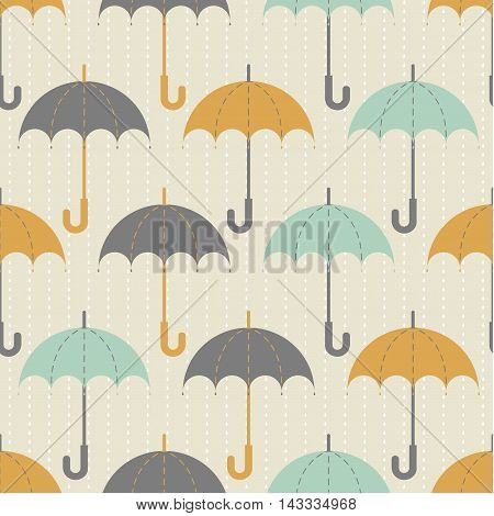 Seamless texture. Autumn. Depicts the umbrellas of the same size .Umbrella in three colors : grey, yellow and blue .Umbrellas in the rain. Umbrellas on a beige background.