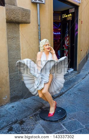 Marilyn Monroe Sculpture In Front Of An Amusement Arcade In Florence. Monroe Was Actress And Model,